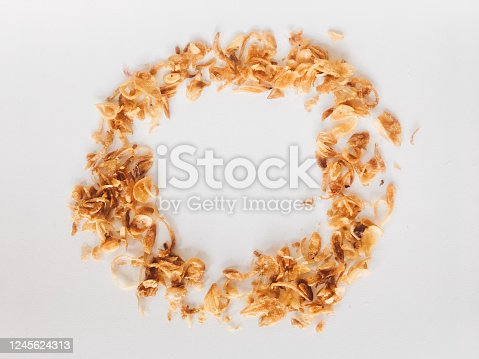 Pile of Onion fries (Bawang Goreng) or shallots with circle shape isolated white background.