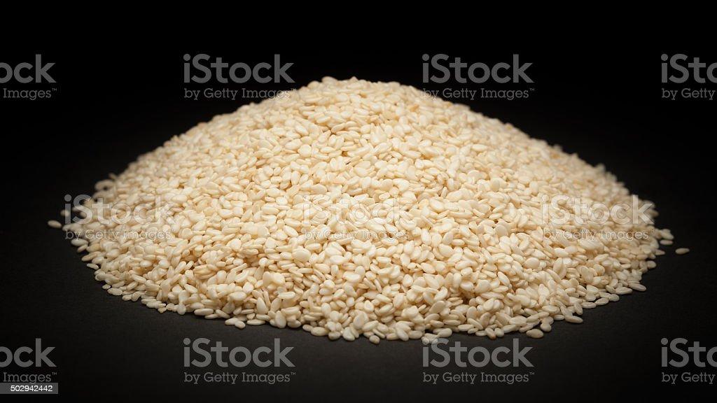 Pile of Organic Sesame white (Sesamum indicum) stock photo