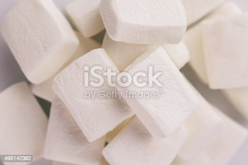 istock Pile of original white marshmallows in red pastel background. 495142362