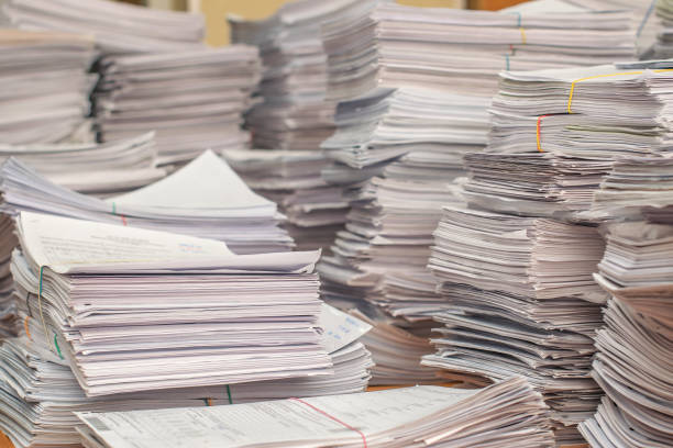 pile of paper documents in the office bundles bales of paper documents. stacks packs pile on the desk in the office document stock pictures, royalty-free photos & images