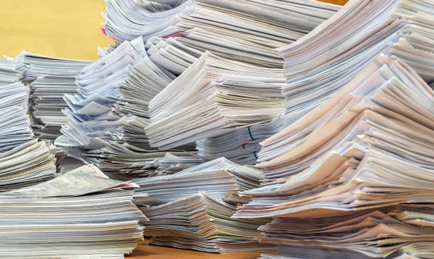 pile of paper documents in the office bundles bales of paper documents. stacks packs pile on the desk in the office bureaucracy stock pictures, royalty-free photos & images