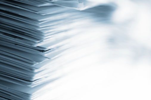 Pile of papers with high key effect