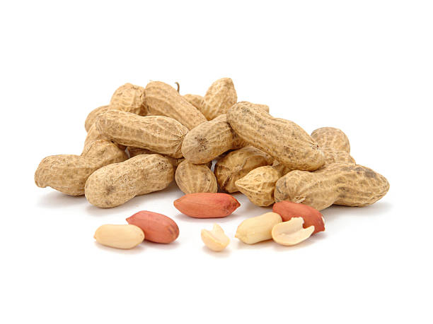 A pile of peanuts on a white background stock photo