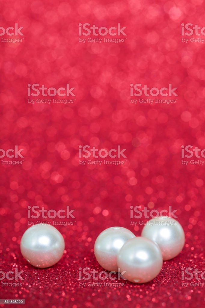 Pile of pearls on red christmas background stock photo