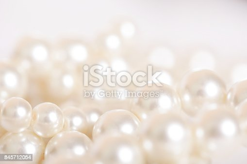 istock Pile of pearls on the white background 845712054
