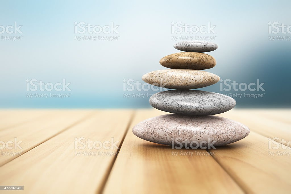 Pile of pebbles on wooden planks stock photo