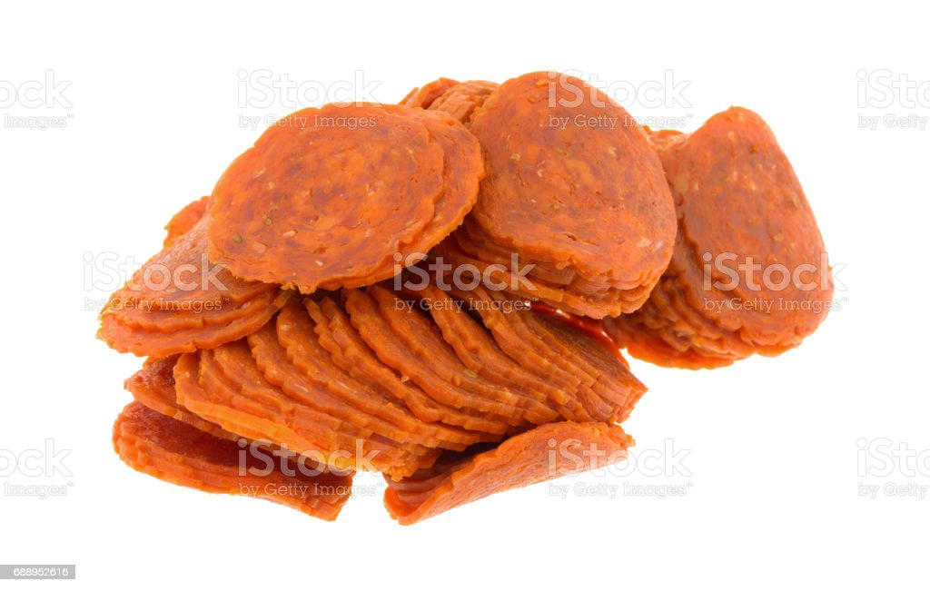 Pile of pepperoni slices on a white background stock photo