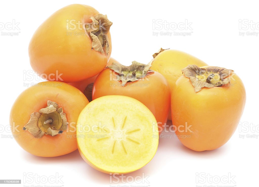 Pile of persimmon fruits on white background royalty-free stock photo