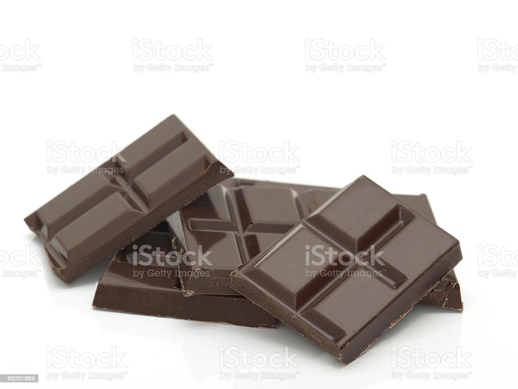 Pile of pieces of chocolate bars stock photo