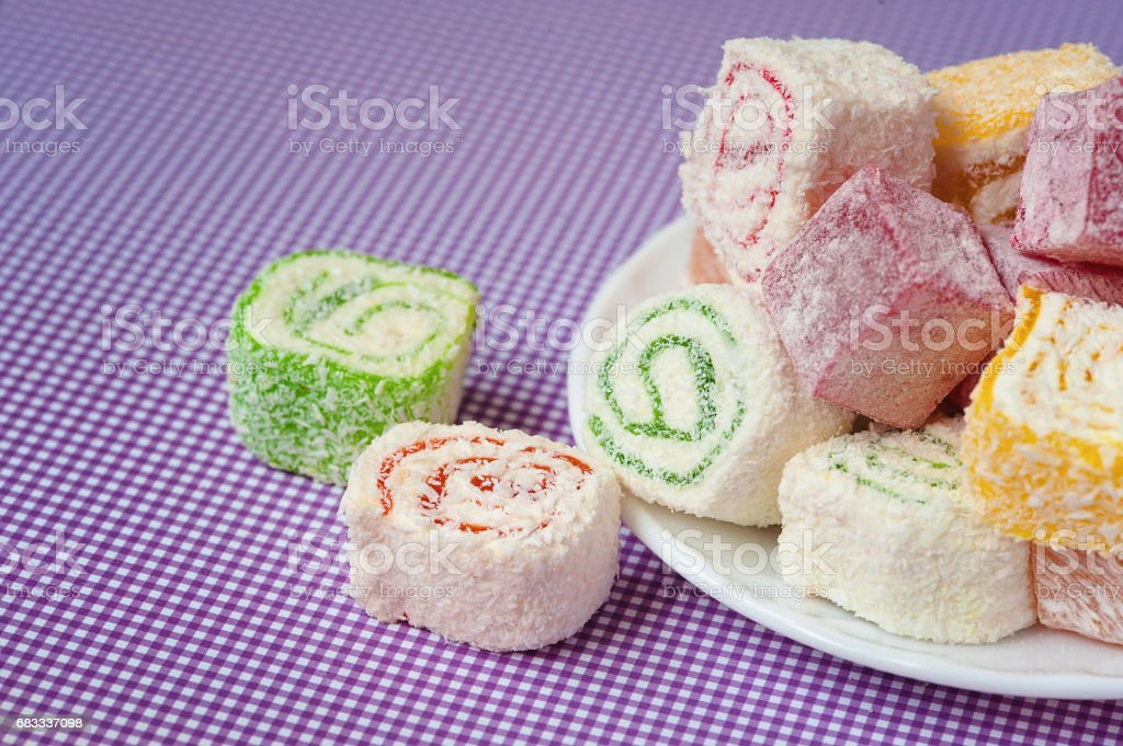 Pile of pieces of turkish delight lokum on a white plate royalty-free stock photo