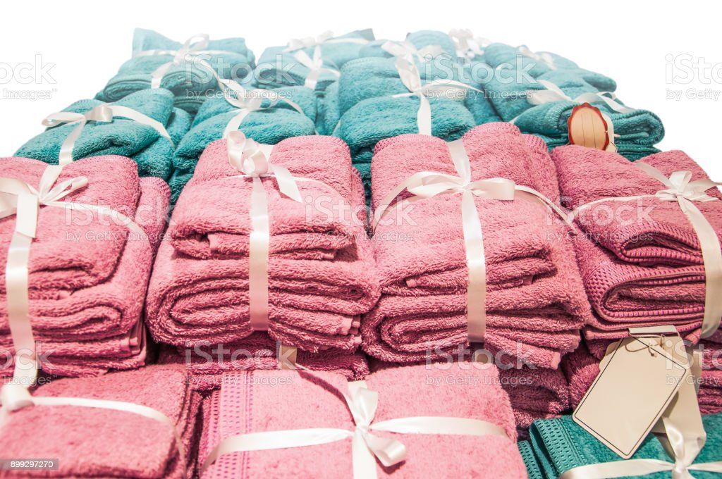 A pile of pink and blue towels bow tie stock photo