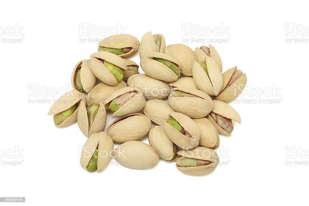 Pile of pistachios on white background royalty-free stock photo