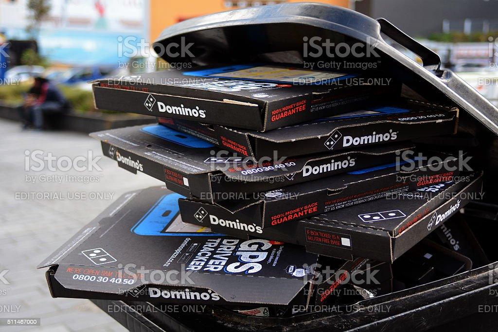 Pile of Pizza Hut boxes in a Rubbish Bin stock photo