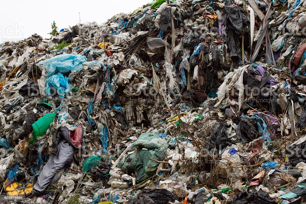 Pile of plastic bags and other refined petroleum products dumped stock photo