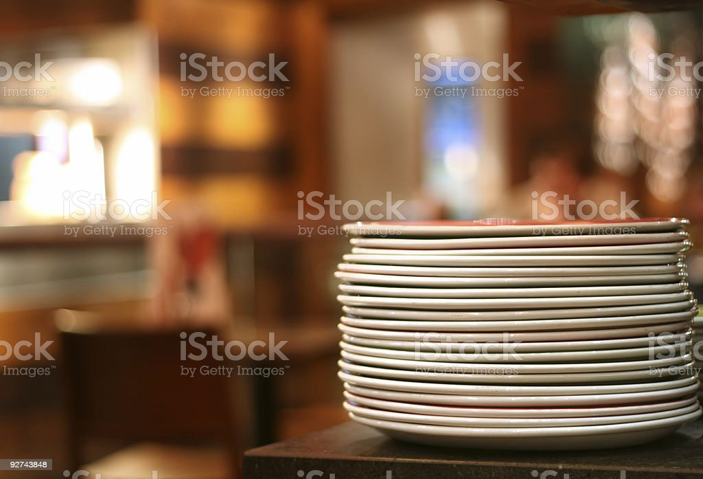 pile of plates stock photo
