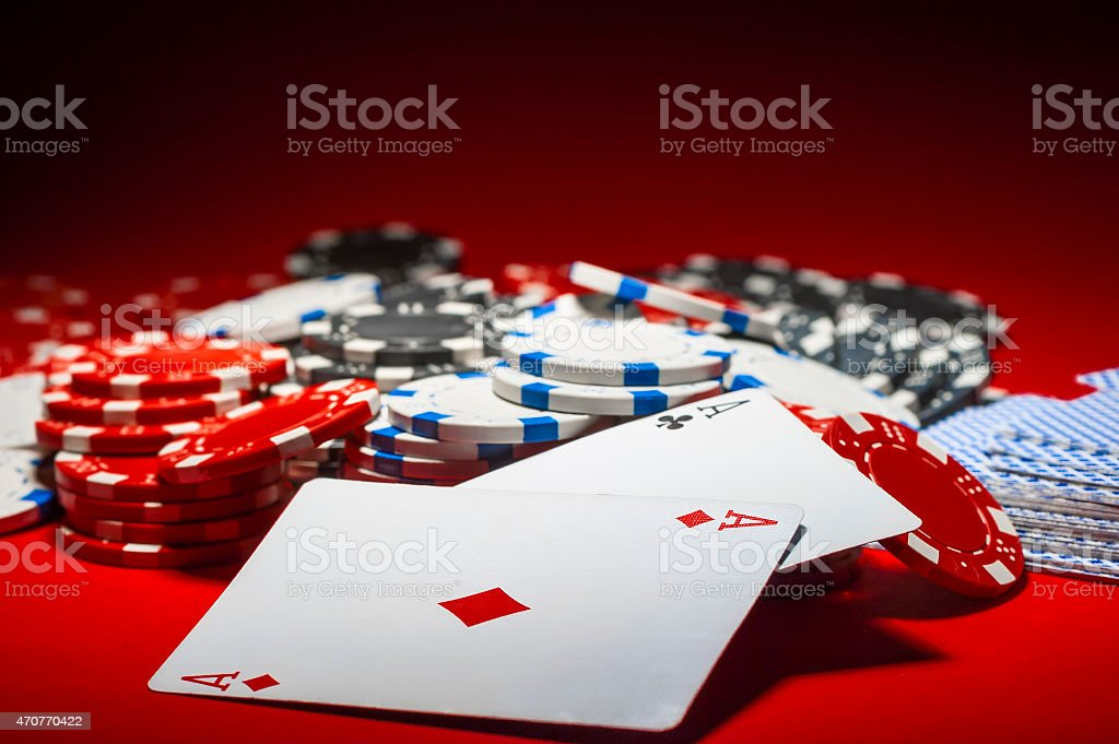 pile of poker chips and a pair of aces stock photo