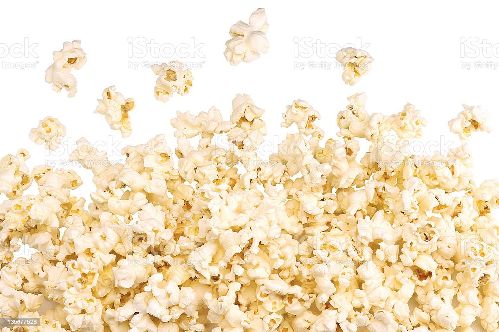 A pile of popping popcorn against a white background stock photo