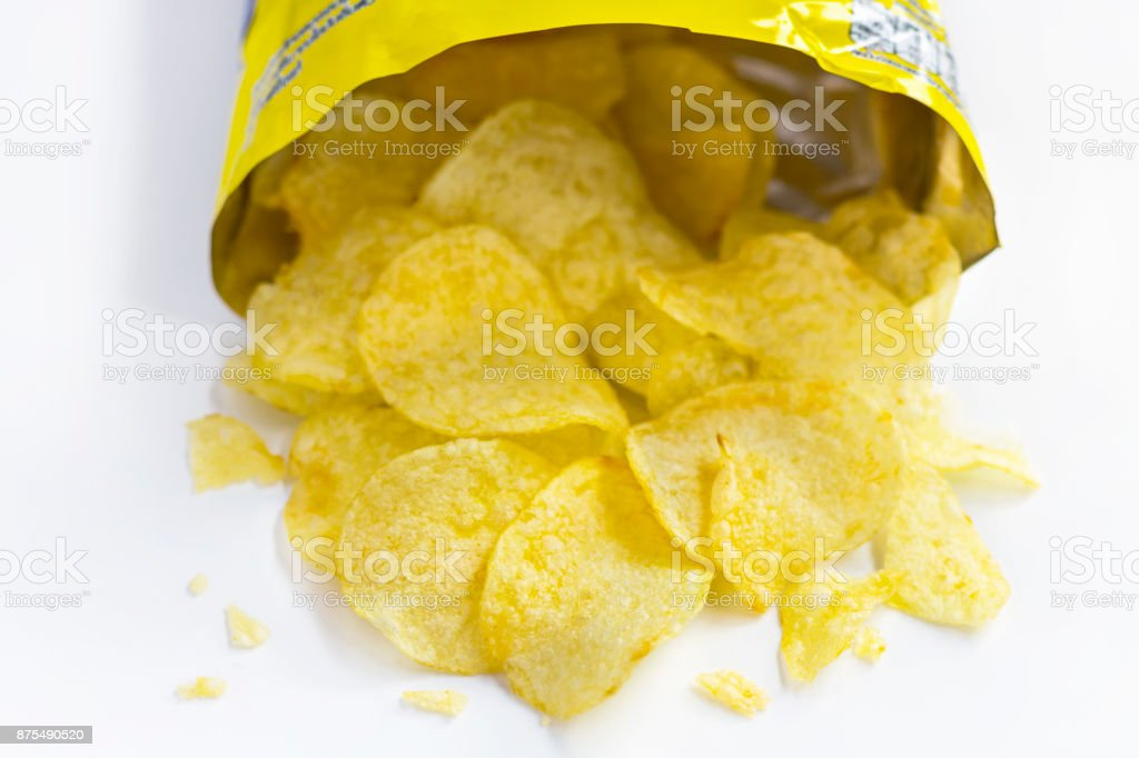 A pile of potato chips on white background stock photo