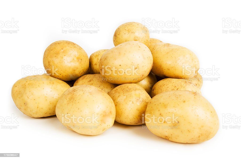 A pile of potatoes on a plain white background royalty-free stock photo