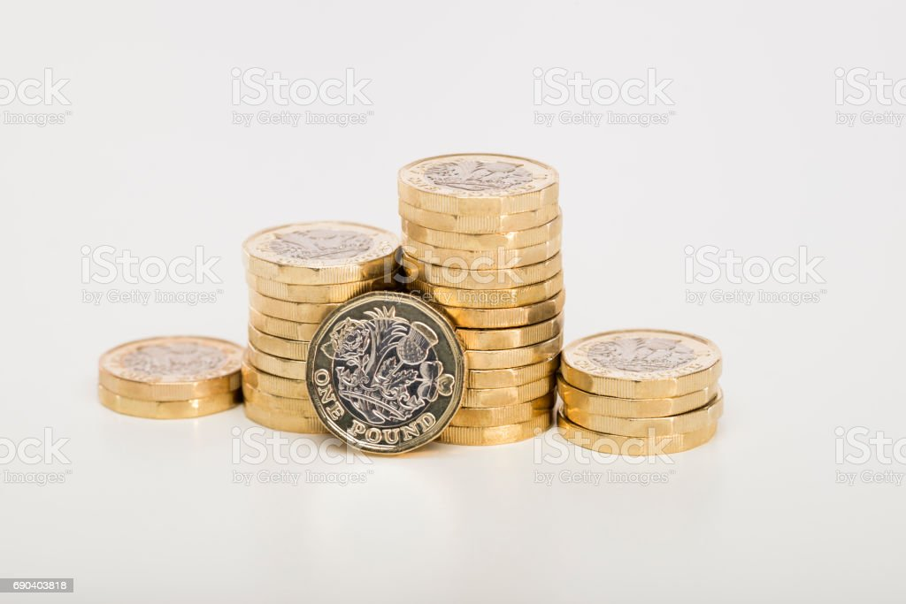 Pile of Pound coins stock photo
