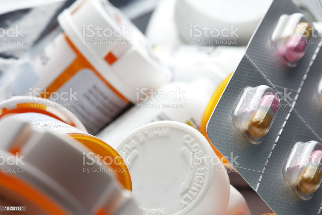 Pile of prescription drug bottles and a blister pack royalty-free stock photo