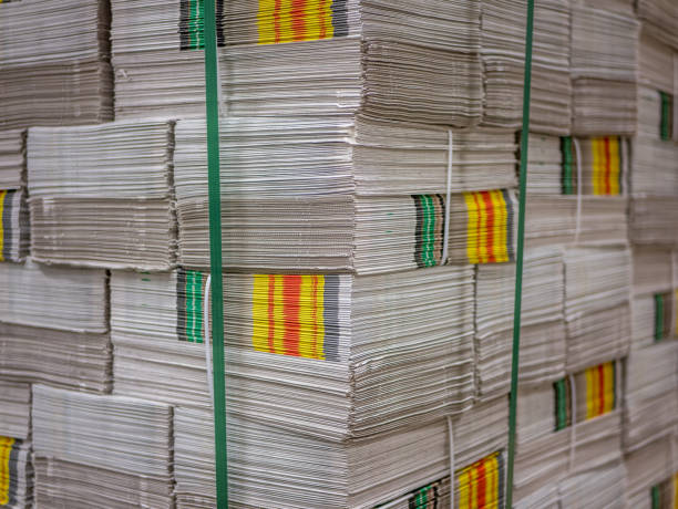 Pile of prints or newspapers stack on a pallet. stock photo