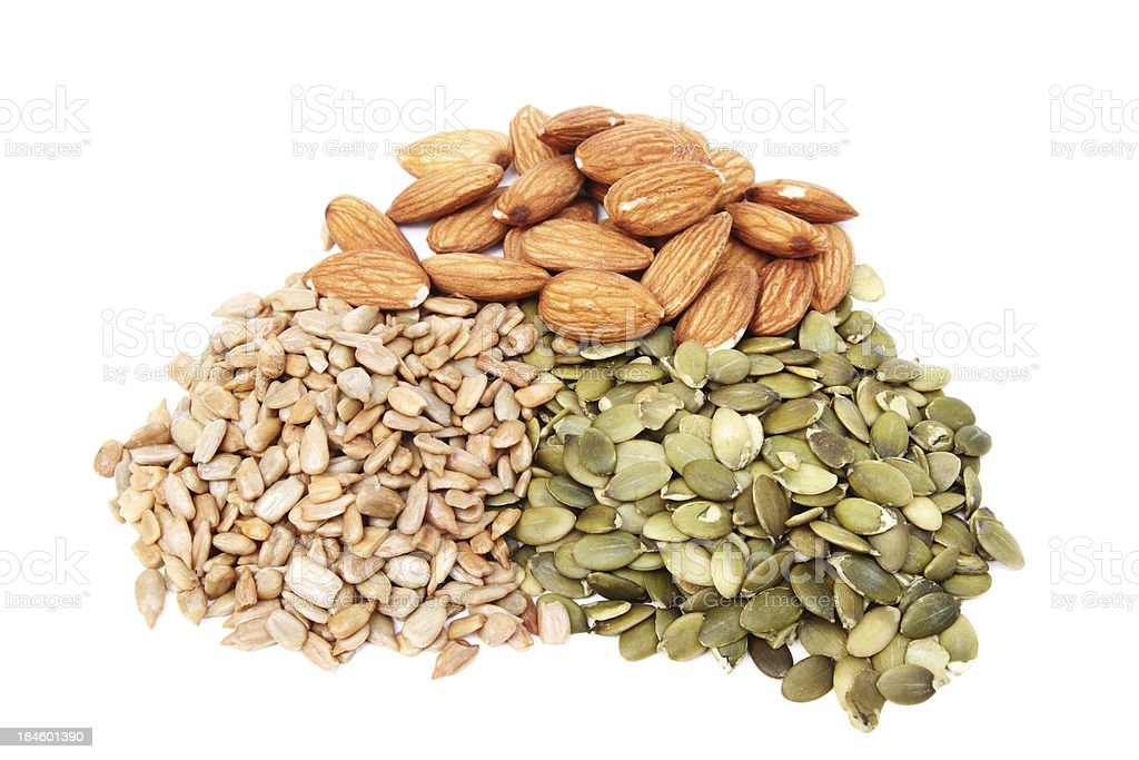 Pile of pumpkin and sunflower seeds with almonds royalty-free stock photo