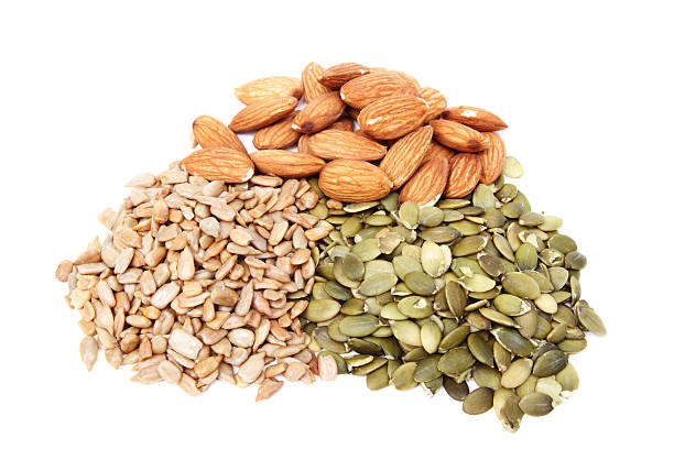 Pile of pumpkin and sunflower seeds with almonds stock photo
