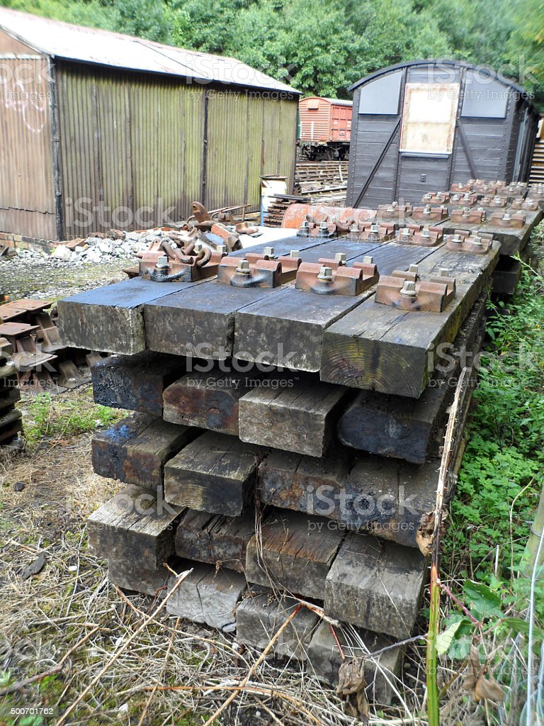 Pile of Railway Sleepers and Junk Yard Materials stock photo
