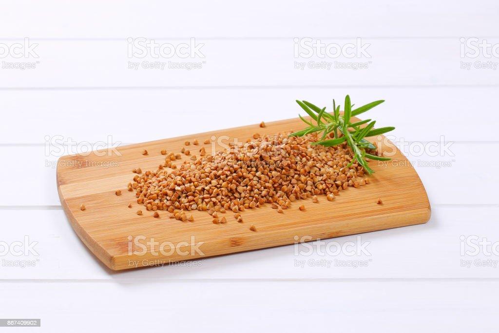 pile of raw buckwheat stock photo