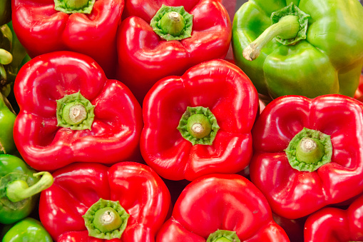 Pile of red and green peppers