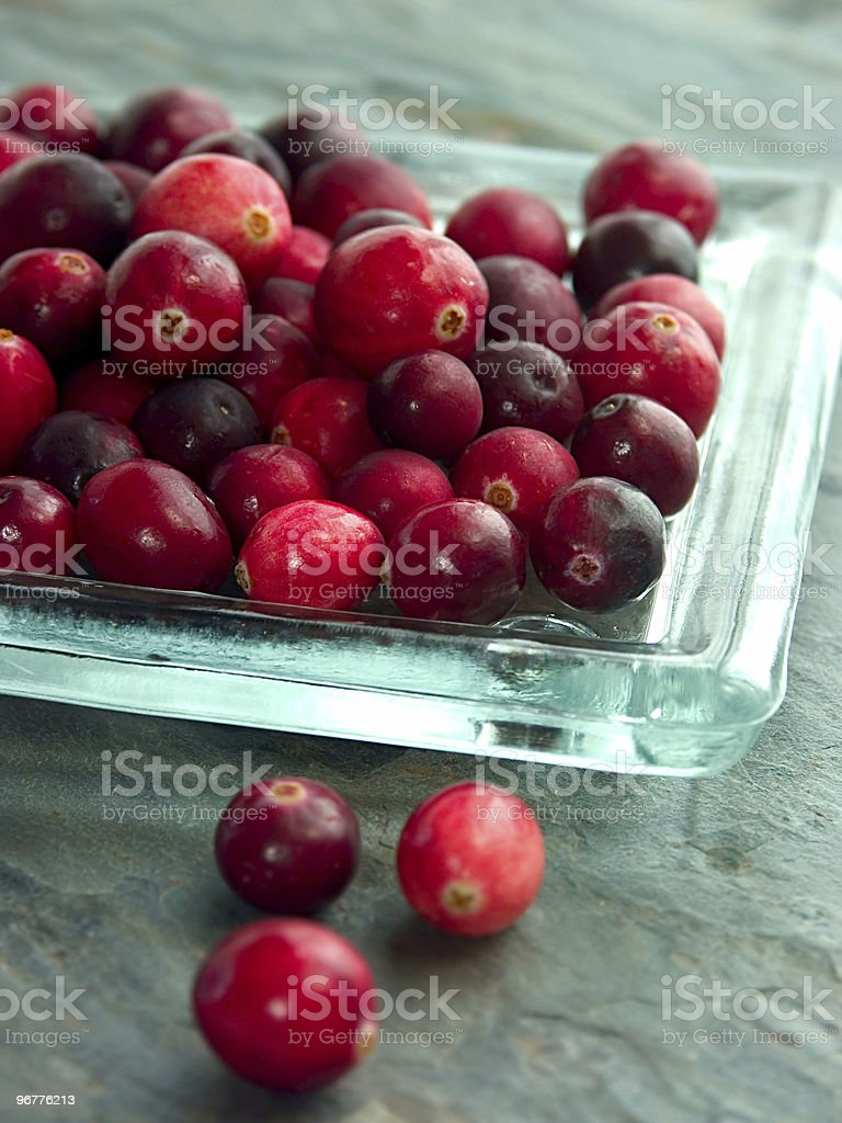 A pile of red cranberries on a glass plate royalty-free stock photo