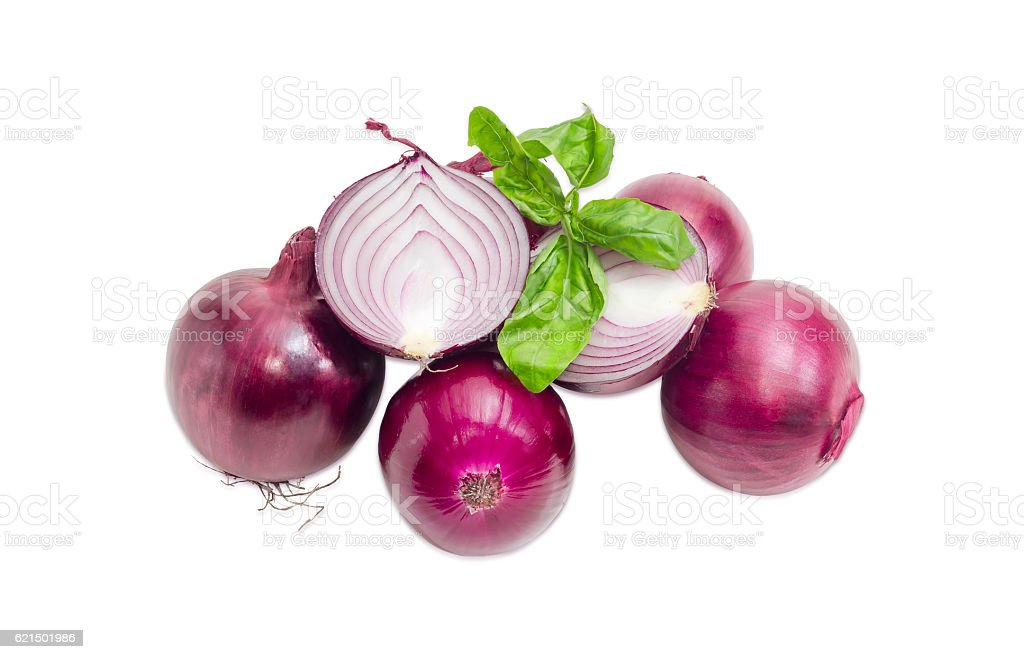 Pile of red onion and twig of basil photo libre de droits