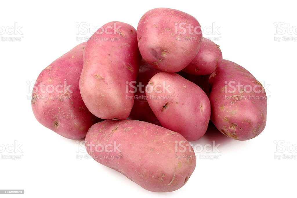 A pile of red potatoes on a white background stock photo