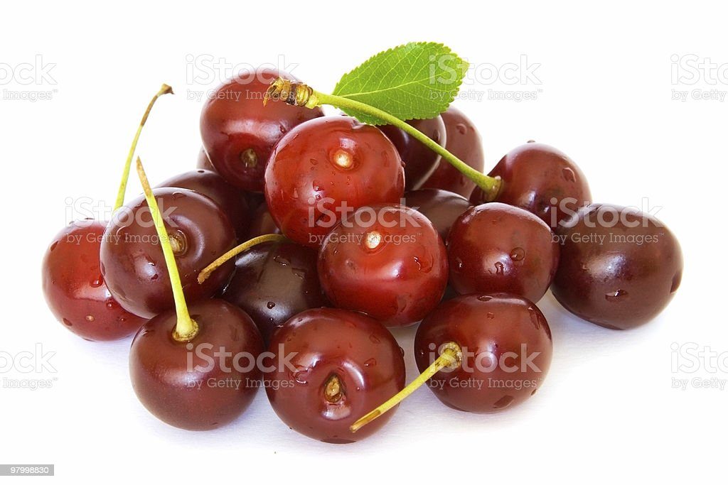 Pile of red ripe sour cherries on white stock photo