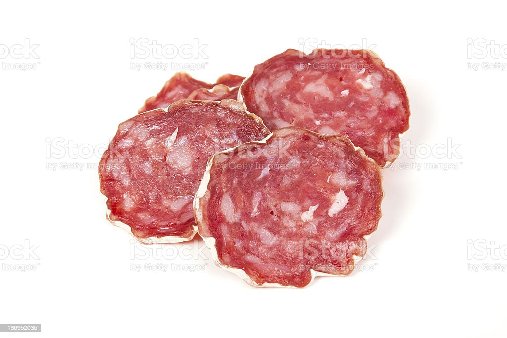 pile of red salami, on a white royalty-free stock photo