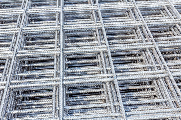 Pile of reinforcing mesh, armature, background, pattern Spikes of rebar grid, reinforcing mesh, steel bars stacked for construction. cusp stock pictures, royalty-free photos & images