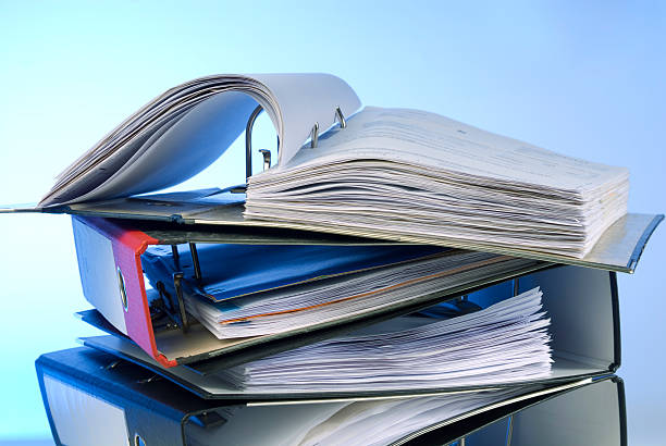 Pile of ring binders with open binder on top stock photo