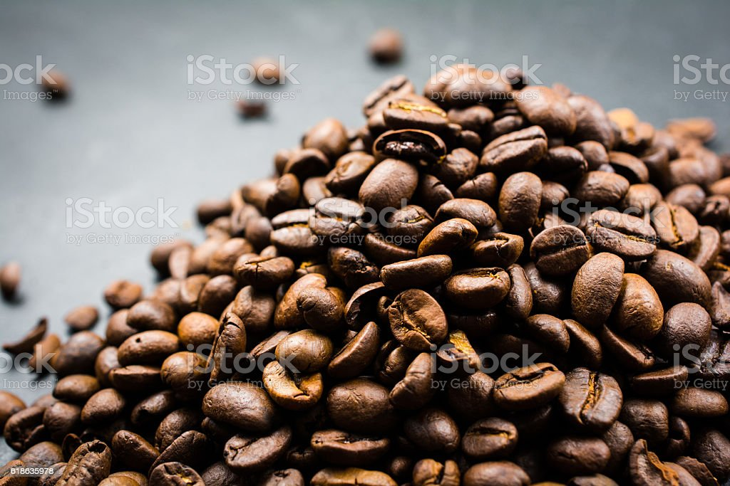 Pile of Roasted Coffee Beans on Black Background stock photo