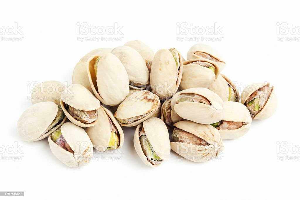 A pile of roasted pistachios with a white background stock photo
