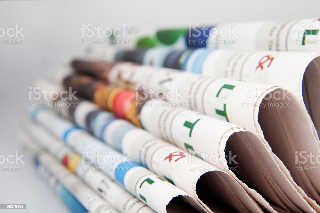 Pile of rolled over newspaper  stock photo