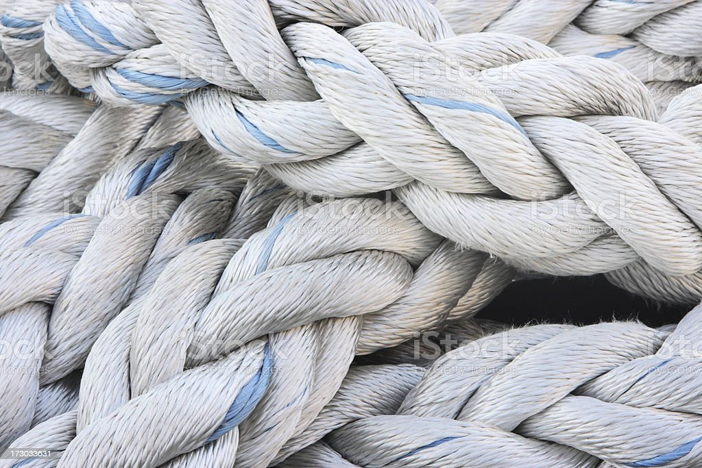 A pile of rope all braided together stock photo