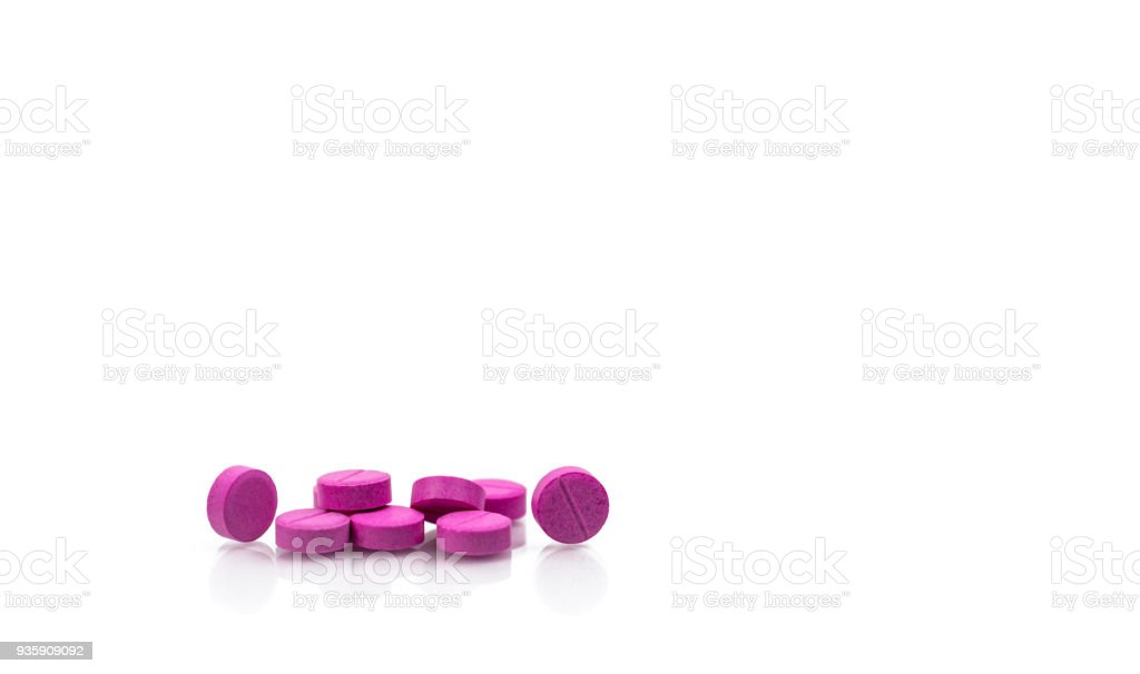 Pile of round pink small tablets pills isolated on white background with copy space for text. Bronchodilator medicine for treatment asthma in adult. Salbutamol (Albuterol) tablets pills. stock photo
