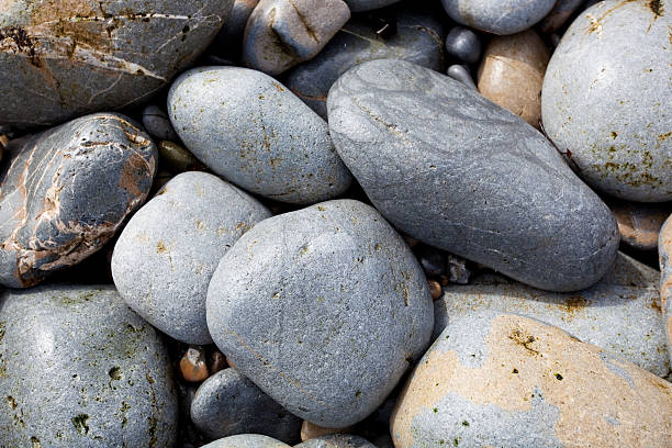 Pile of Rounded Rocks on the Beach stock photo