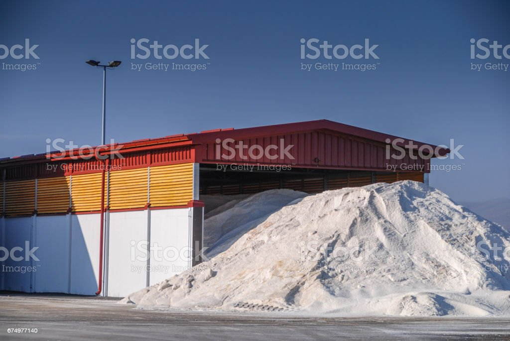 Pile of salt outside the hangar stock photo