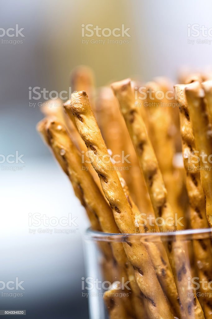 pile of salted sticks in a glass stock photo
