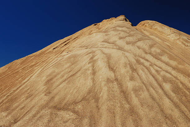 Pile of sand and blue sky stock photo