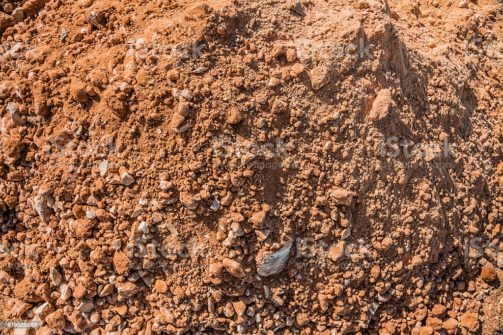 Pile of sand and stones at a construction site stock photo