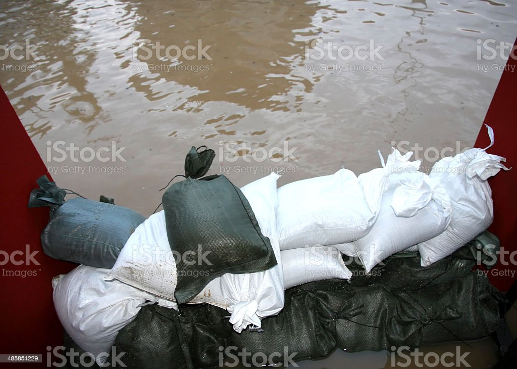 pile of sandbags in defense from the water stock photo