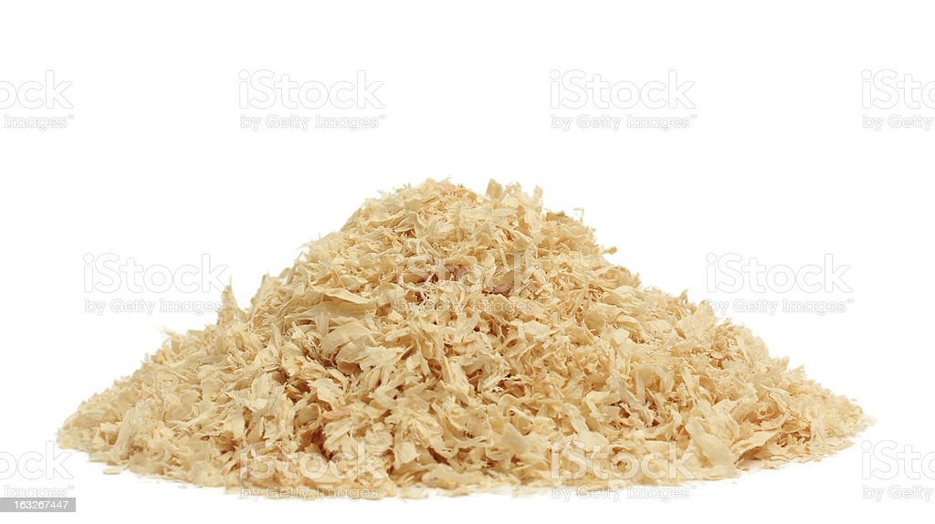 A pile of sawdust on a white background stock photo